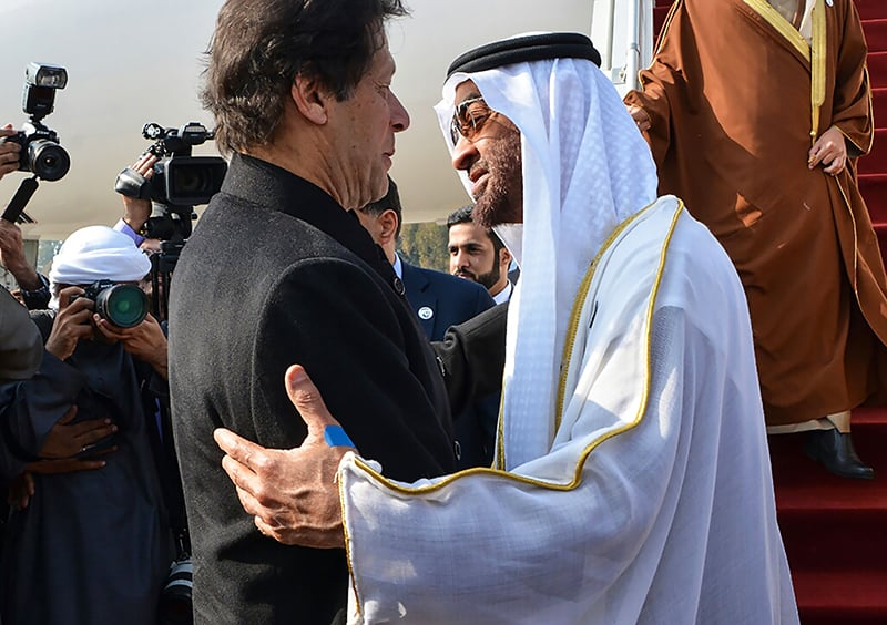 Prime Minister Imran Khan hugged the crown prince as he stepped off the plane at Nur Khan airbase. — AFP