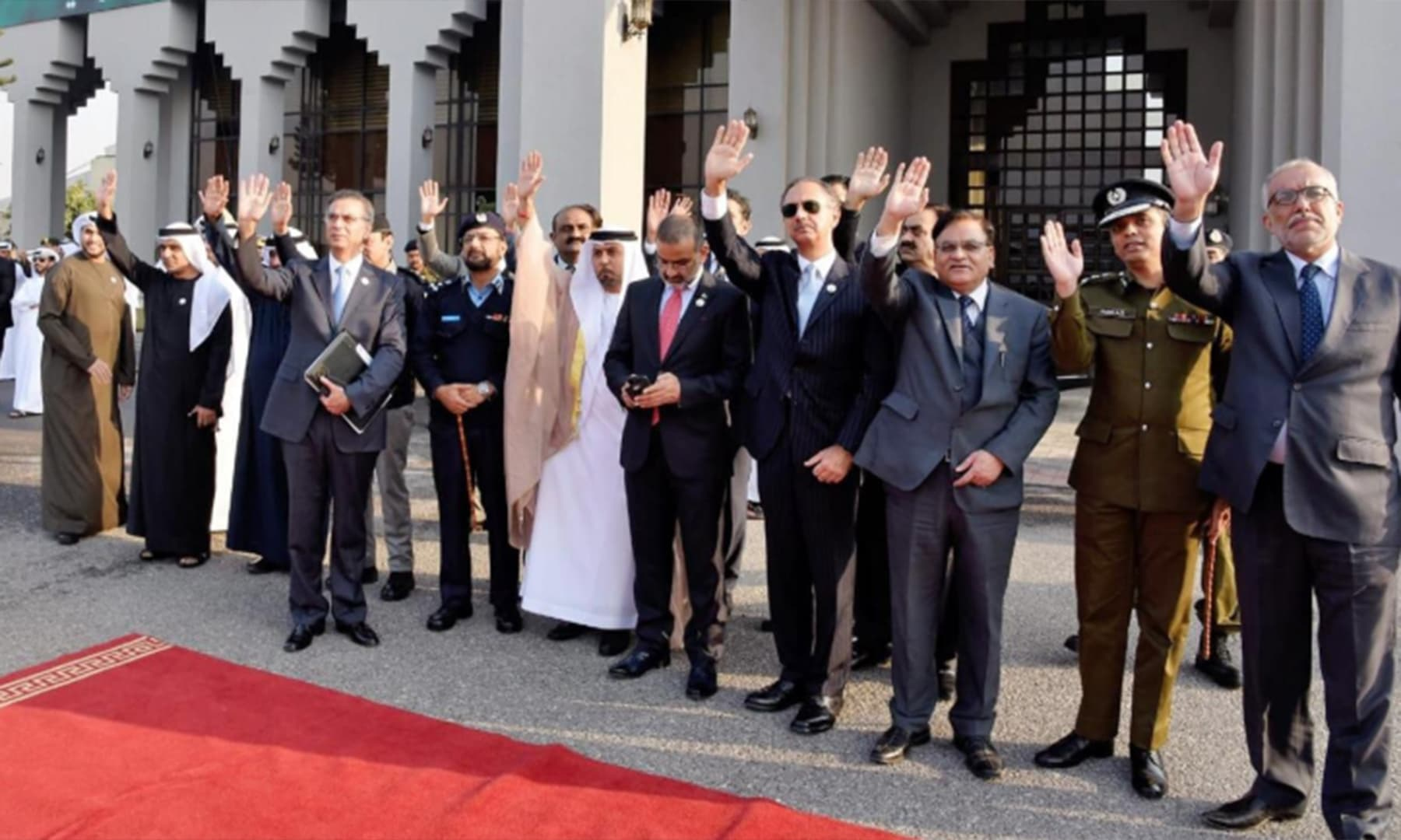 Minister for Energy Omar Ayub Khan waves goodbye to UAE's crown prince upon his departure at Nur Khan airbase. — Photo: PTI Twitter
