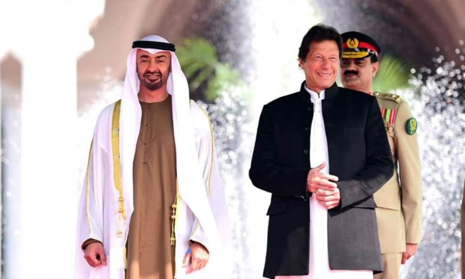 Prime Minister Khan accompanies Crown Prince Sheikh Mohammed at the PM House, where a welcome ceremony was held in his honour. — Photo courtesy PTI official Twitter.