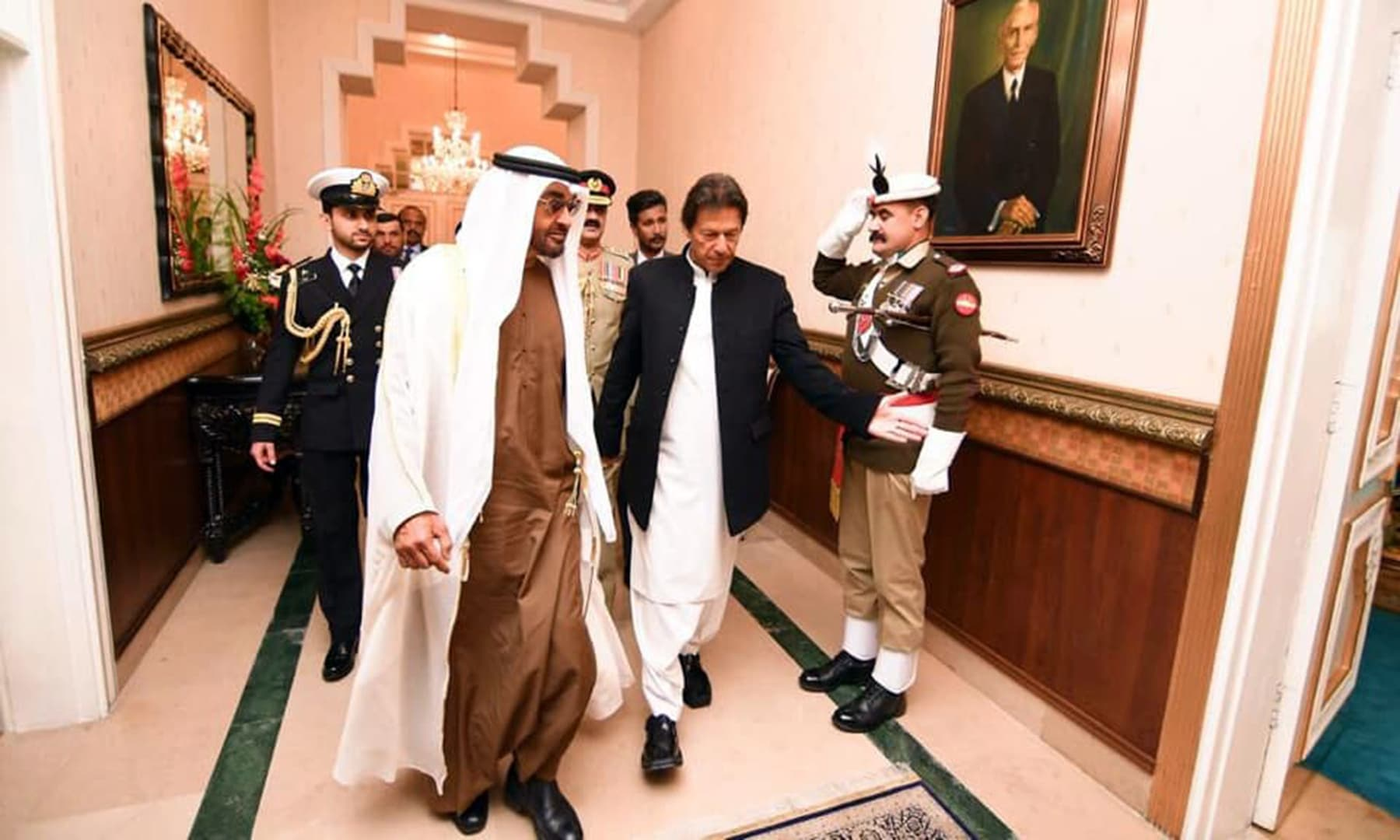 Prime Minister Khan walks with the UAE crown prince inside the PM House. — Photo courtesy: Radio Pakistan