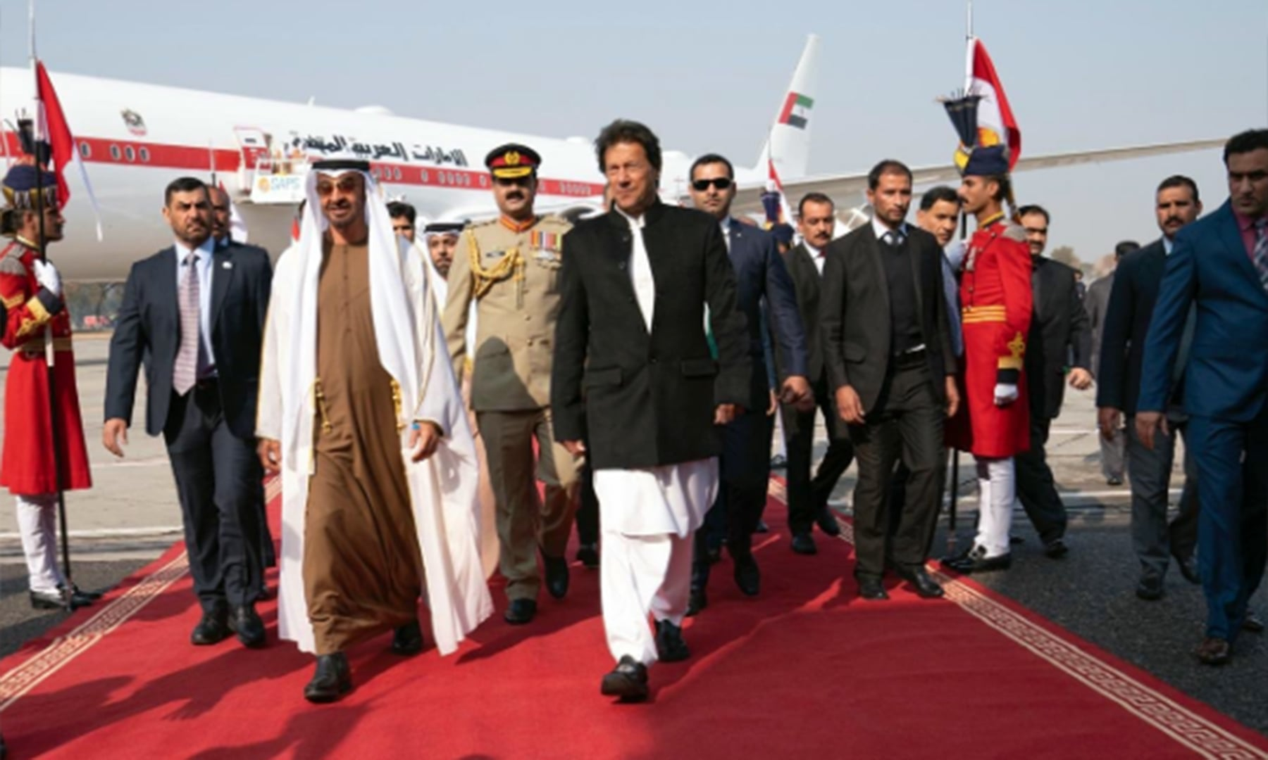 Prime Minister Khan walks with the UAE royal at Nur Khan airbase. — Photo courtesy UAE Embassy PK Twitter