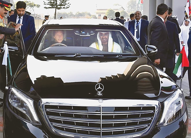 ISLAMABAD: Prime Minister Imran Khan drives Abu Dhabi Crown Prince Sheikh Mohammed bin Zayed Al Nahyan from Noor Khan Airbase to PM House on Sunday.—APP