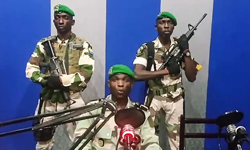 "In this video grab made on a video footage obtained on YouTube on January 7, 2019, Gabon soldiers on state radio called on the people to ""rise up"" and announced a ""national restoration council"" would be formed, as an ailing President Ali Bongo is out of the country. — AFP"