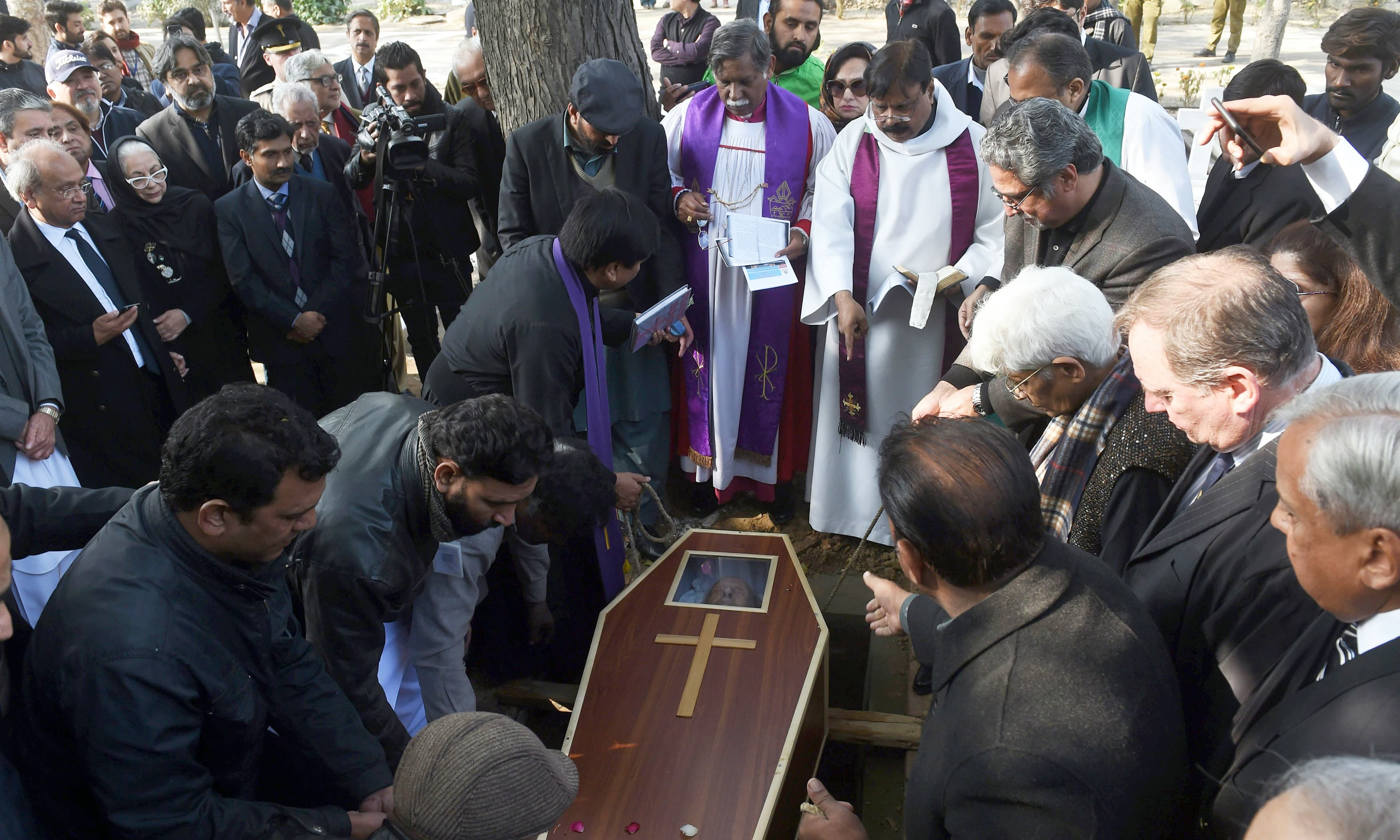 Colleagues and students bury Geoffrey Douglas in Lahore. —AFP
