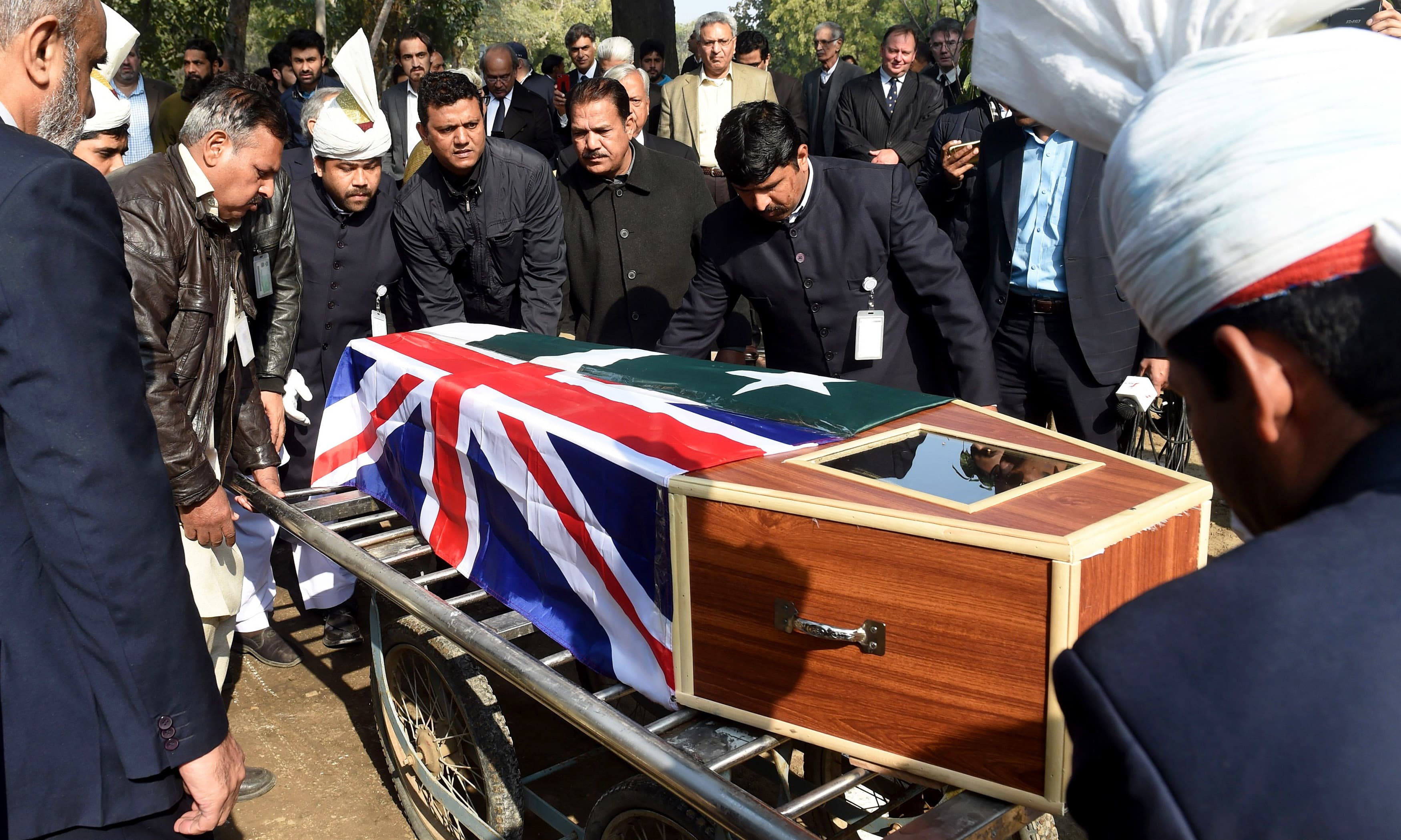 Colleagues and students carry the coffin of Geoffrey Douglas. —AFP