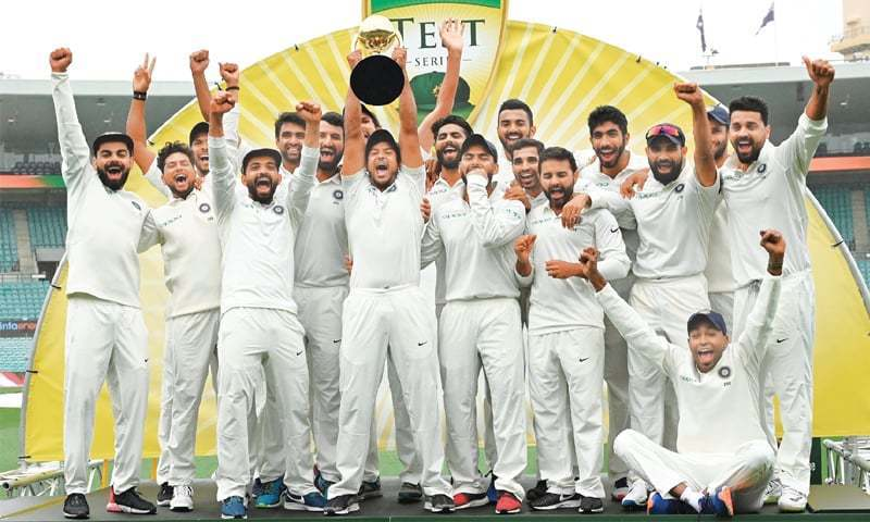 Indian players celebrate with the Border-Gavaskar Trophy after winning the series against Australia at the Sydney Cricket Ground on Monday.—AFP/ File photo