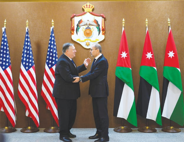 AMMAN: US Secretary of State Mike Pompeo (left) greets Jordanian Foreign Minister Ayman Safadi at the start of a Middle East tour on Tuesday.—Reuters