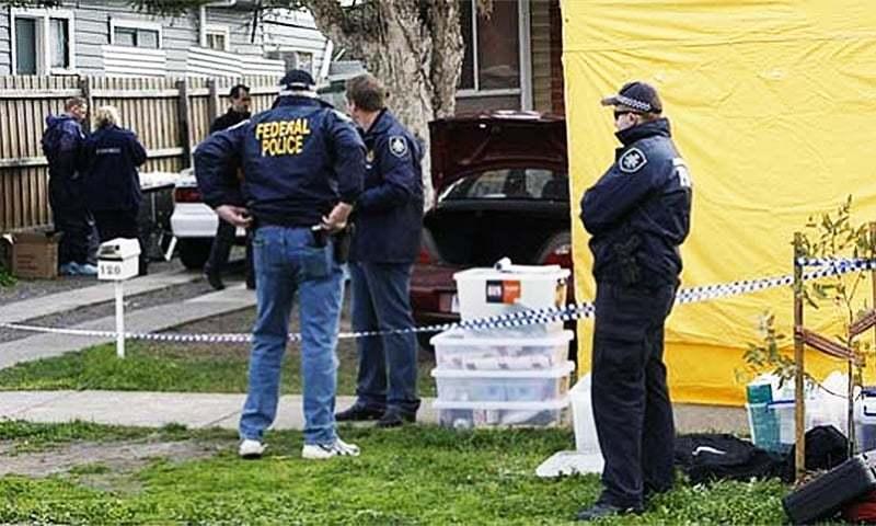 A file photo of Australian police examining a crime scene.
