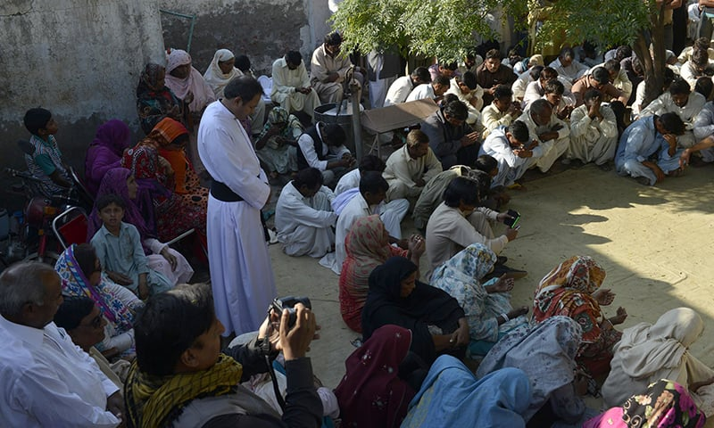 Pakistani Christians gather and pray for a murdered Christian couple in Kot Radha Kishan in 2014- AFP/Arif Ali