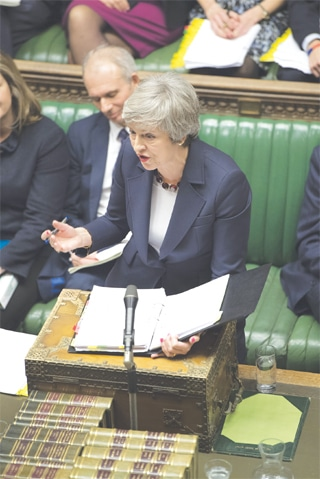 LONDON: British Prime Minister Theresa May speaks in the House of Commons on Wednesday.—AP
