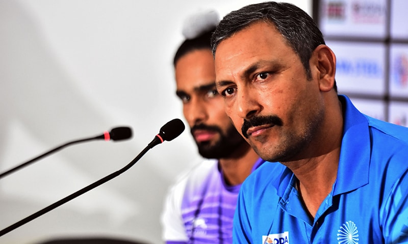 In this file photo taken on December 1, 2018 India's field hockey coach Harendra Singh (R) takes part in a press conference at Kalinga Stadium in Bhubaneswar. ─ AFP