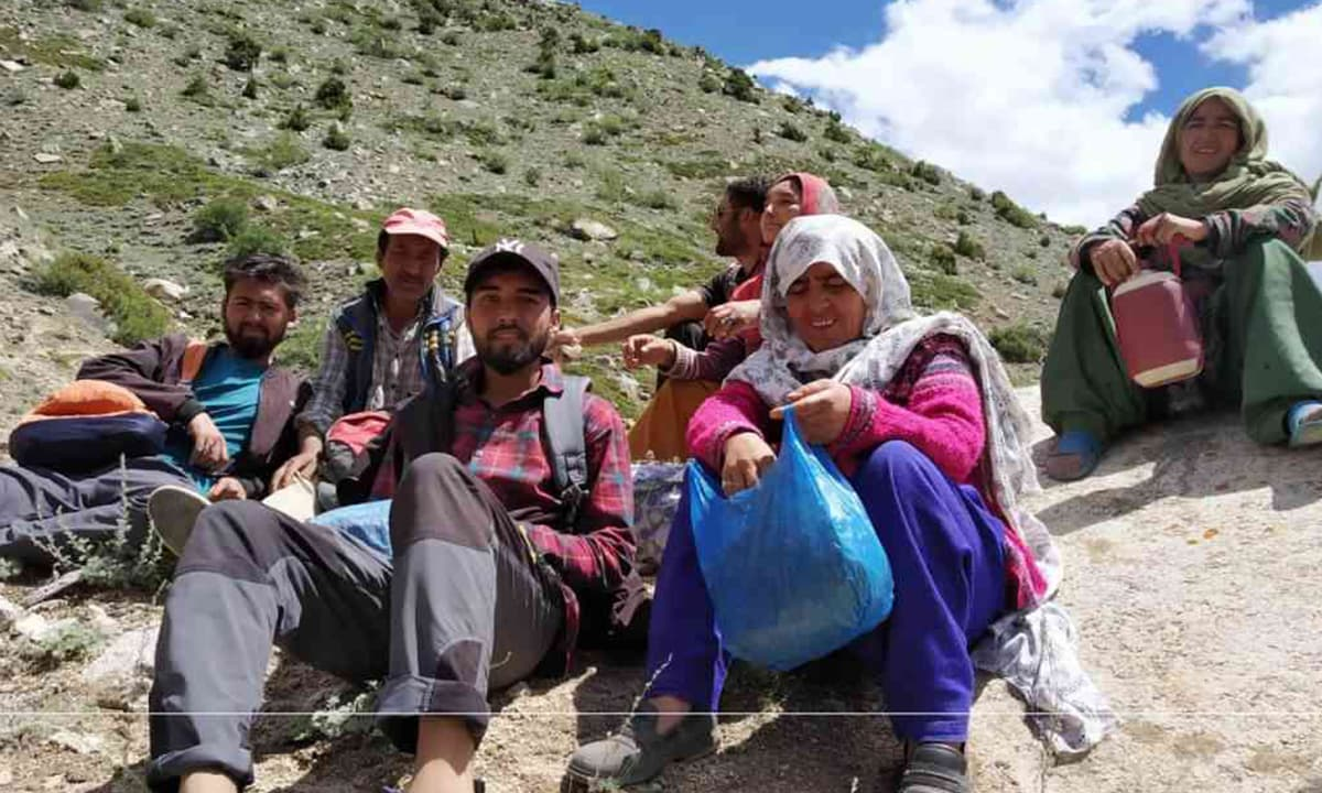 Latoo residents take a break from laying a water pipeline | Photo credit: Talib Hussein