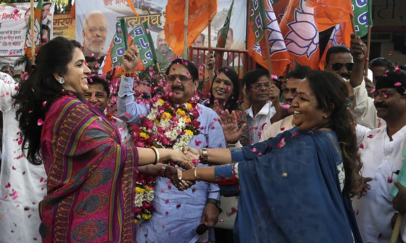 Supporters of India's ruling Bharatiya Janata Party celebrate India's Parliament Wednesday approving a bill providing a 10 percent quota in government jobs for poor upper caste members in Mumbai, India, Thursday, Jan 10, 2019. (AP Photo/Rajanish Kakade) — Copyright 2018 The Associated Press.All right reserved