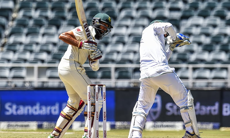 South Africa's batsman Hashim Amla, looks back as wicketkeeper Sarfraz Ahmed catches the ball.—AP