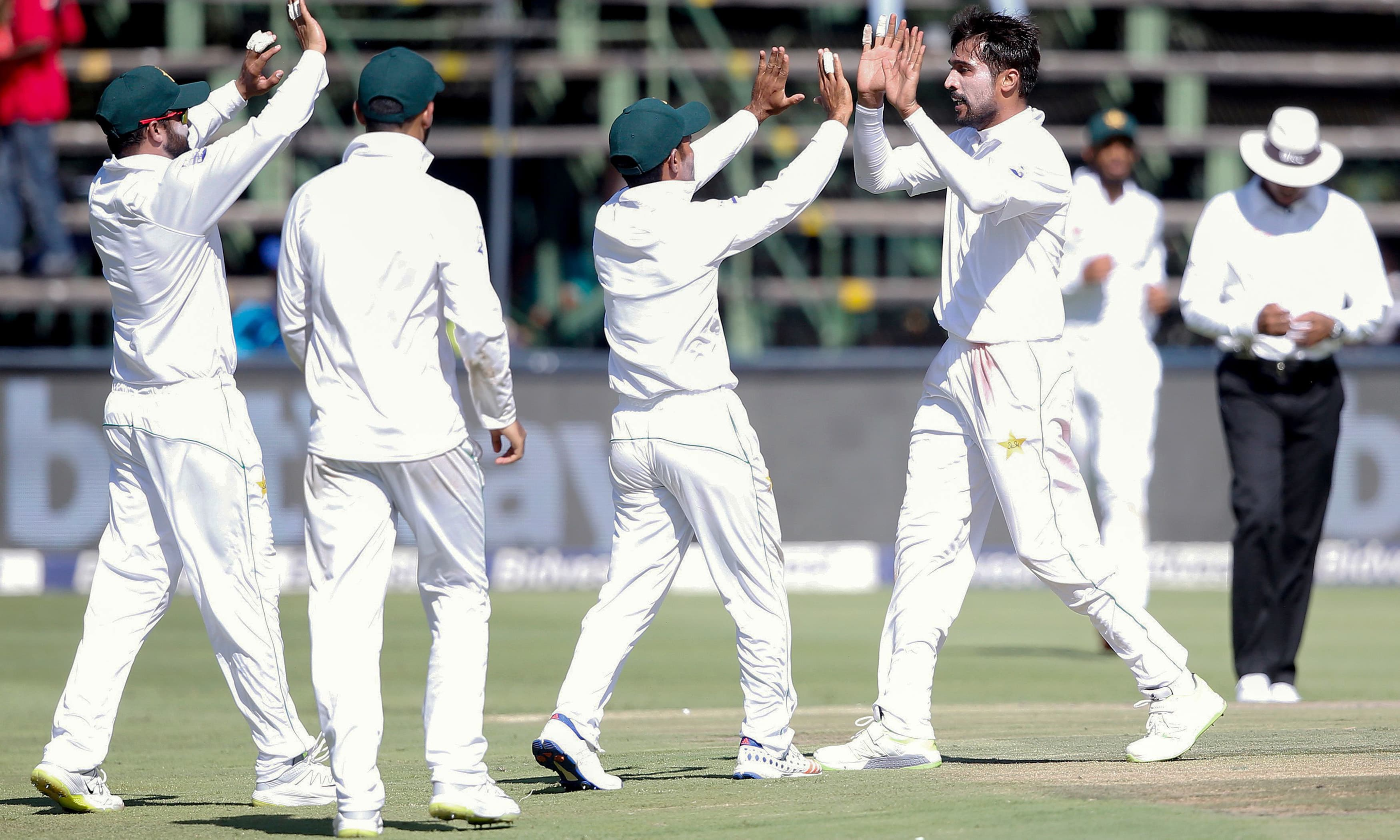 Mohammad Amir celebrates the dismissal of South Africa's batsman Zubayr Hamza during the first day of the third Cricket Test match. —AFP