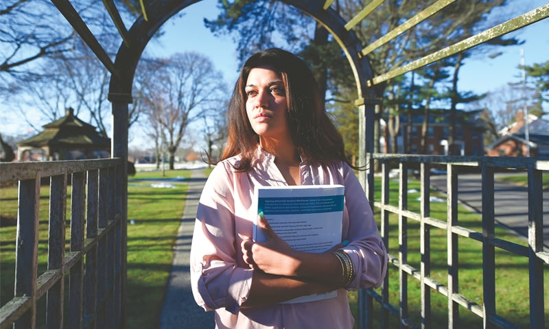In this Feb 2, 2016, file photo, Naila Amin, 26, holds a book from  one of the classes she was taking at Nassau Community College  in Garden City, New York. She was forcibly married at 13 in Pakistan  and applied for papers for her 26-year-old husband to come to  the US.—AP