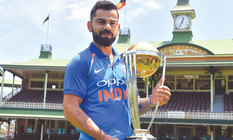 SYDNEY: Indian captain Virat Kohli poses with the ICC World Cup trophy at the Sydney Cricket Ground on Friday.—AFP