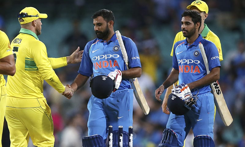 Australia's captain Aaron Finch, left, shakes hands with India's Mohammed Shami, centre, and Bhuvneshwar Kumar, right, at the end of the match. —AP