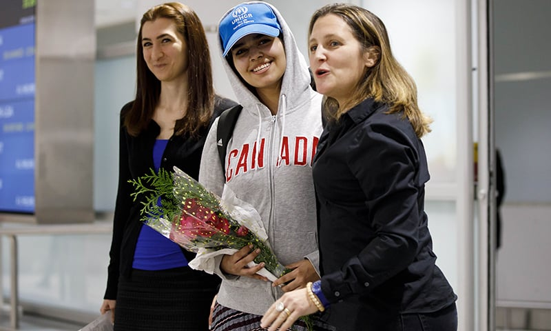 Asylum Seeker Rahaf Mohammed al-Qunun, 18, smiles as she is introduced to the media at Toronto Pearson International Airport. —AFP