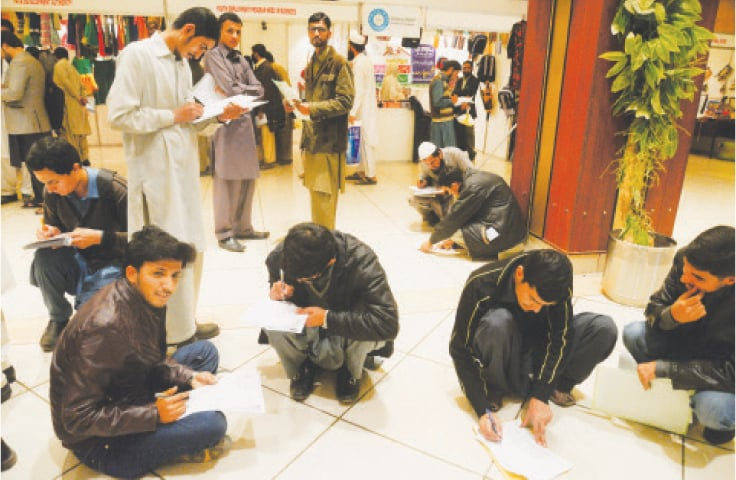 While young men such as these fill forms at a job fair organised in Peshawar by the Sarhad Chamber of Commerce and Industry, most know that their chances are slim to begin with as foreign-qualified graduates have now entered the job market | Shahbaz Butt/White Star
