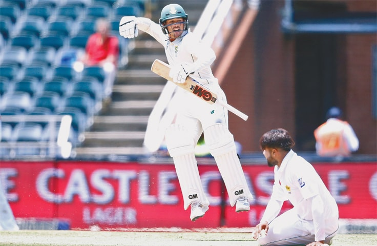 JOHANNESBURG: Pakistan paceman Faheem Ashraf (R) watches South African batsman Quinton de Kock punches the air in delight after reaching  his century in the third and final  Test at the Wanderers on Sunday.—AFP