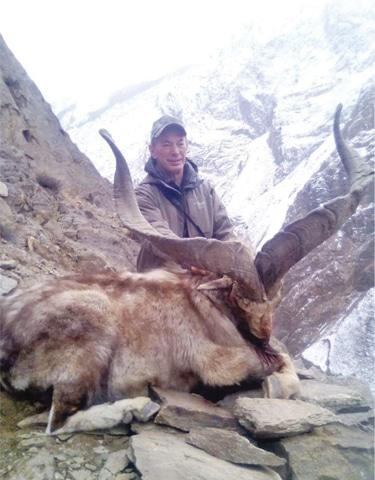 John Amistoso with the Astore Markhor he hunted in Bunji area of Gilgit. — Dawn