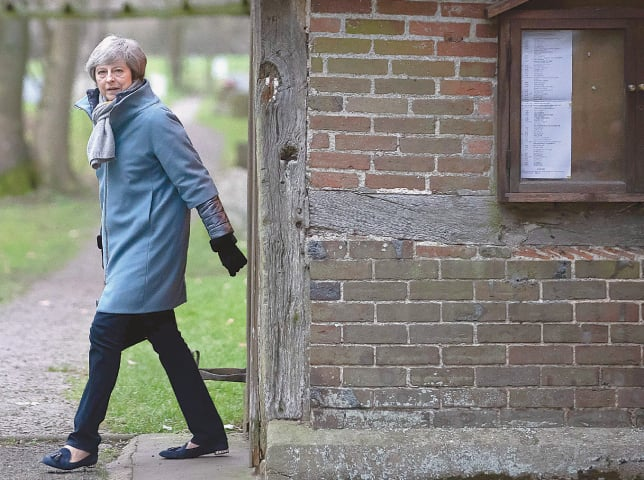 MAIDENHEAD (UK): Britain's Prime Minister Theresa May leaves after attending a church service on Sunday.—AFP