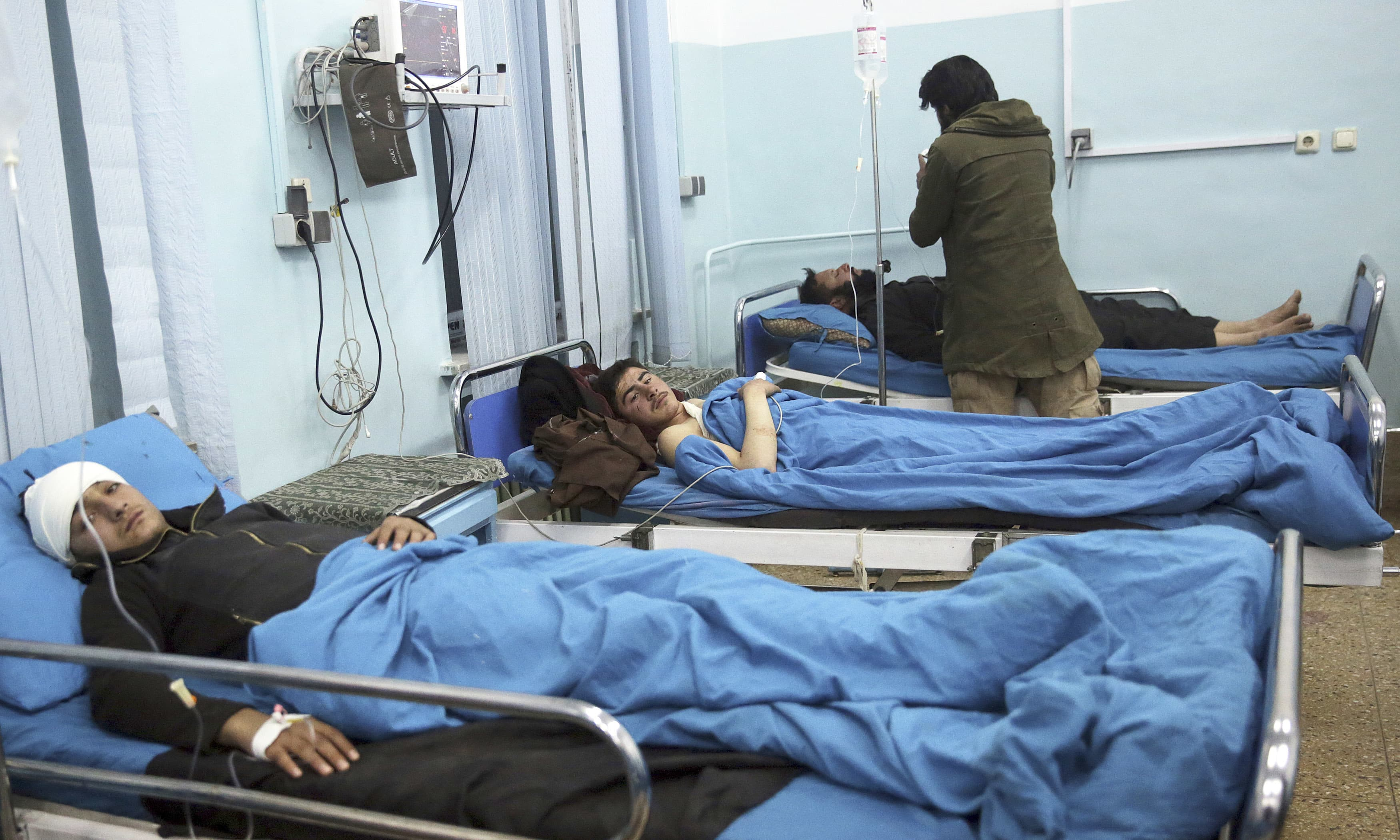 Wounded men lie on beds in a hospital in Kabul. —AP
