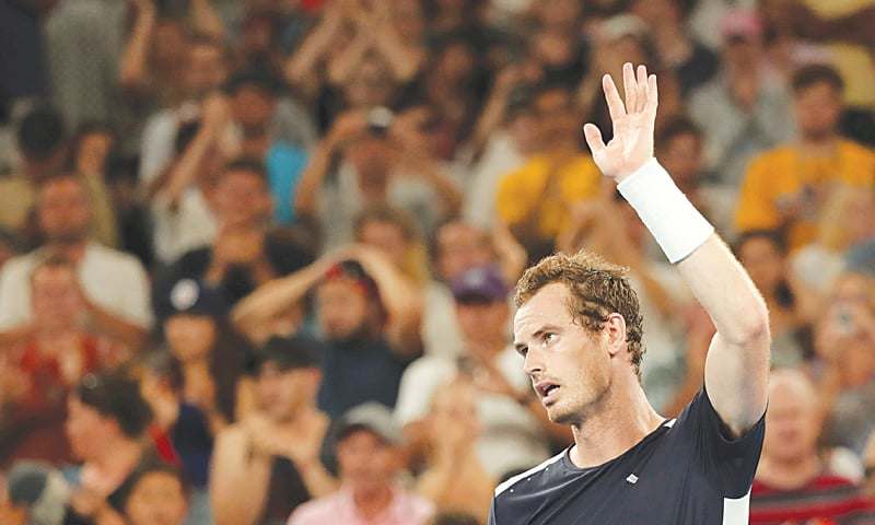 MELBOURNE: Britain's Andy Murray waves to the crowd after losing the Australian Open first-round match to Roberto Bautista Agut of Spain on Monday.—Reuters
