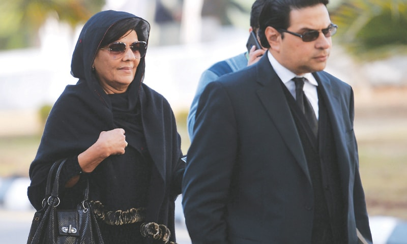 ISLAMABAD: Aleema Khanum, the sister of Prime Minister Imran Khan, arrives with her lawyer at the Supreme Court to attend the hearing of foreign assets case on Monday. Ms Khanum appeared before the court in connection with her undeclared property abroad.—AFP