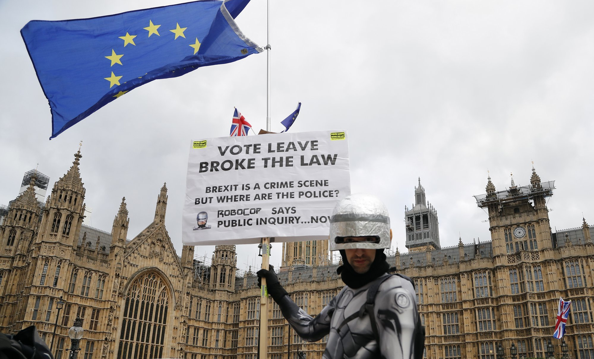 A protestor dressed as a robot demonstrates opposite the Houses of Parliament as Pro-European demonstrators protest in London on Monday. — AFP