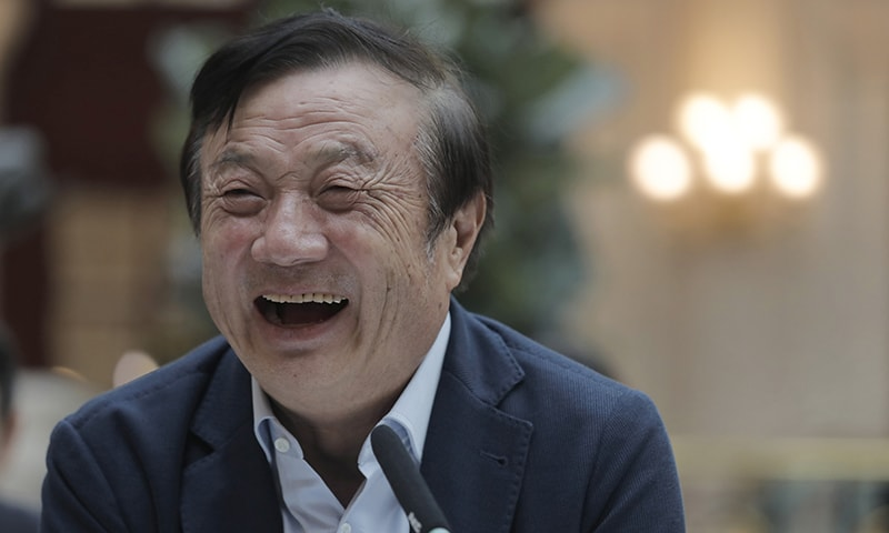 Ren Zhengfei, founder and CEO of Huawei, laughs during a round table meeting with the media in Shenzhen city, south China's Guangdong province, on Tuesday. — AP