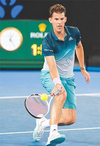 DOMINIC Thiem of Austria returns a shot to France's Benoît Paire at the Australian Open.—AFP