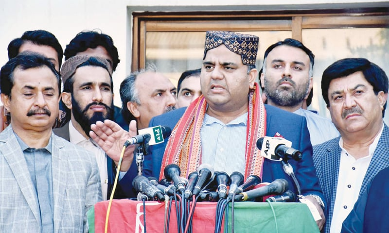 FEDERAL Information Minister Fawad Chaudhry speaks to the media at the residence of Sindh PTI leader Haleem Adil Shaikh on Tuesday.—PTI