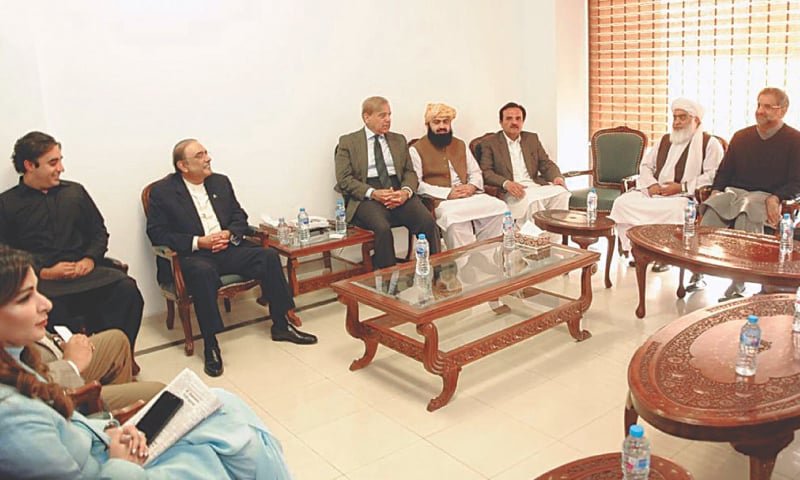 LEADER of the Opposition in the National Assembly Shahbaz Sharif chairing a meeting of opposition parties in the Parliament House on Tuesday. Former president Asif Ali Zardari, PPP chairman Bilawal Bhutto-Zardari, Senator Sherry Rehman and former prime minister Shahid Khaqan Abbasi are also seen.—INP