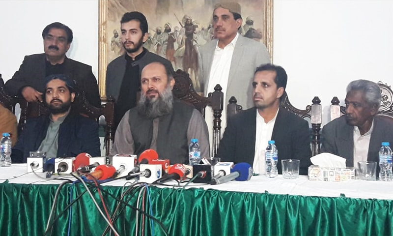 Balochistan Chief Minister Jam Kamal Khan Alyani (2L) addresses a news conference alongside Voice for Baloch Missing Persons vice chairman Mama Qadeer Baloch and other officials in Quetta on Wednesday. — Photo by author