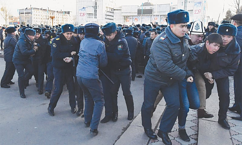 Bishkek: Kyrgyz police officers detain supporters of opposition politician Amanbol Babakulov during an anti-China rally at the Ala-Too square on Thursday.—AFP