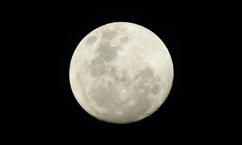 The full moon is seen in the night sky above Sydney, Australia, on  November 13, 2016. — File
