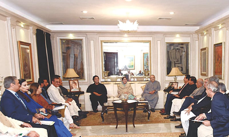 KARACHI: PPP leaders Asif Ali Zardari and Bilawal Bhutto-Zardari chairing a party meeting at Bilawal House on Friday.—PPI