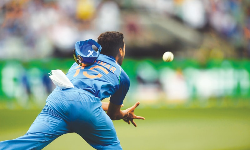 MELBOURNE: India's Bhuvneshwar Kumar takes a catch to dismiss Australia's Glenn Maxwell during the third ODI at the Melbourne Cricket Ground on Friday.—AFP