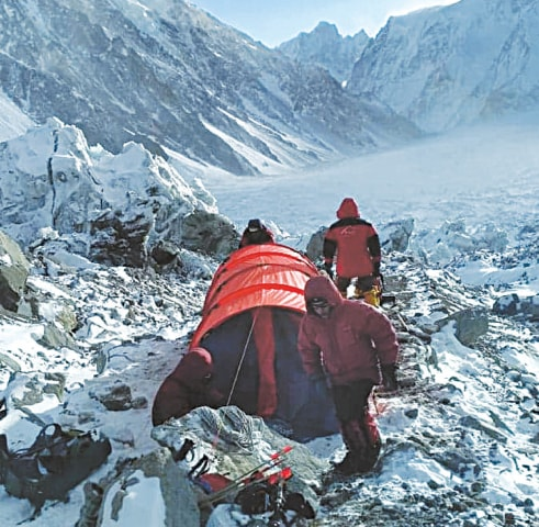 Climbers prepare for ascent at the advanced K2 base camp.—Dawn
