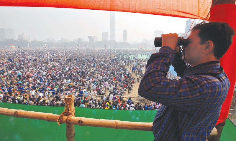 Kolkata: A police officer looks through a pair of binoculars during the 'United India' rally attended by the leaders of India's main opposition parties on Saturday.—Reuters