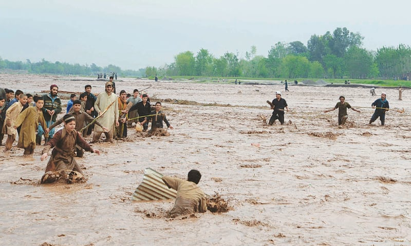Continual rain caused a flood as the Bara River swelled and inundated the Sarband Bhatta Khel area in Peshawar, in 2010  | Shahbaz Butt/White Star