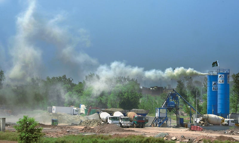 Thick smoke emanates from  a concrete mixing plant installed for the Peshawar BRT project in Sardar Garhi | Abdul Majeed Goraya/White Star