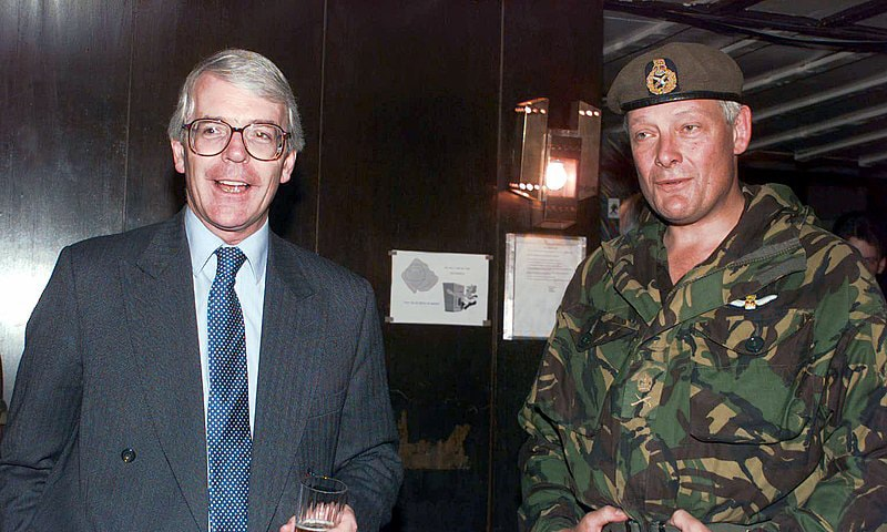 British Prime Minister John Major (L), talks with Lieutenant General Michael Walker (R), Commander, Allied Command Europe Rapid Reaction Corps (ARRC), in the Terme Hotel on Ilidza Compound in Sarajevo, Bosnia and Herzegovina, during Operation Joint Endeavour. — Wikimedia Commons
