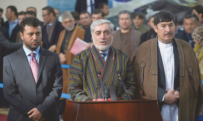 KABUL: Afghan President Ashraf Ghani and (right) Chief Executive Abdullah Abdullah speak to media at the election commission's offices on Sunday after they were registered as candidates for the presidential election to be held in July.—AFP