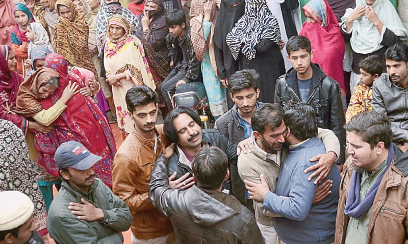 Relatives of Khalil, who was killed along with his wife, daughter and driver in police firing, wail during the funeral on Sunday.—Online