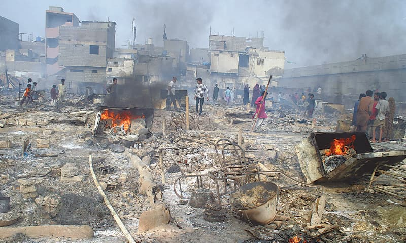 Some trunks still on fire in Federal B Area, where around 300 huts were destroyed on Sunday, belie the fire brigade claim that they had put out the blaze after hours of an operation. — White Star