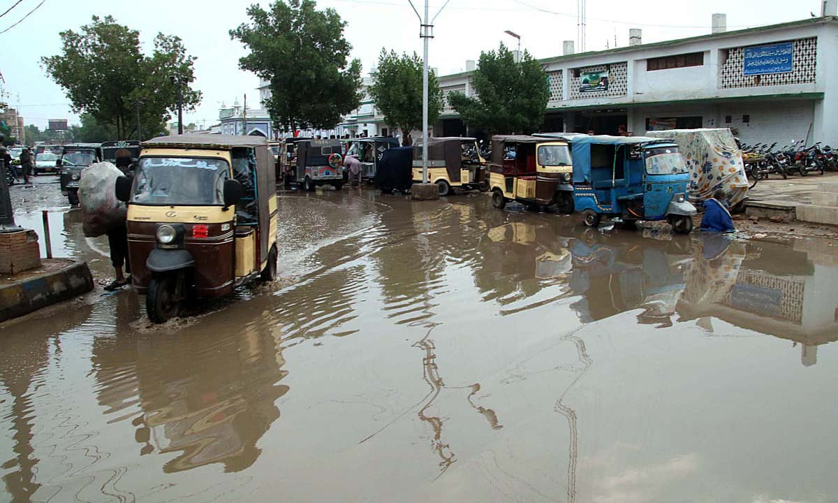 Vehicles passing through rainwater accumulated outside Hyderabad Railway Station. —APP
