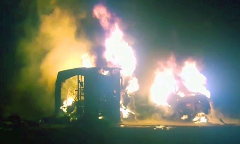 Flames engulf the passenger coach and the tanker after the collision. — DawnNewsTV
